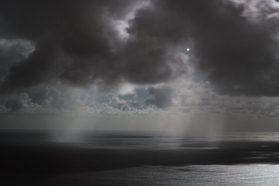 Moonlit rain showers Jupiter